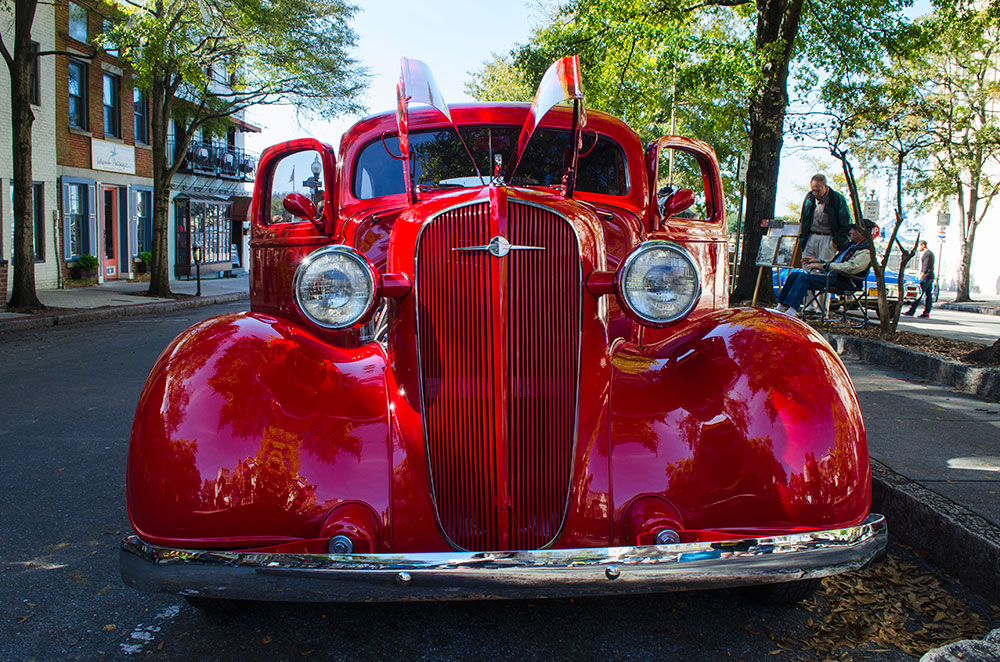A red 1935 Ford Model 48 at Riverfest in Wilmington North Carolina