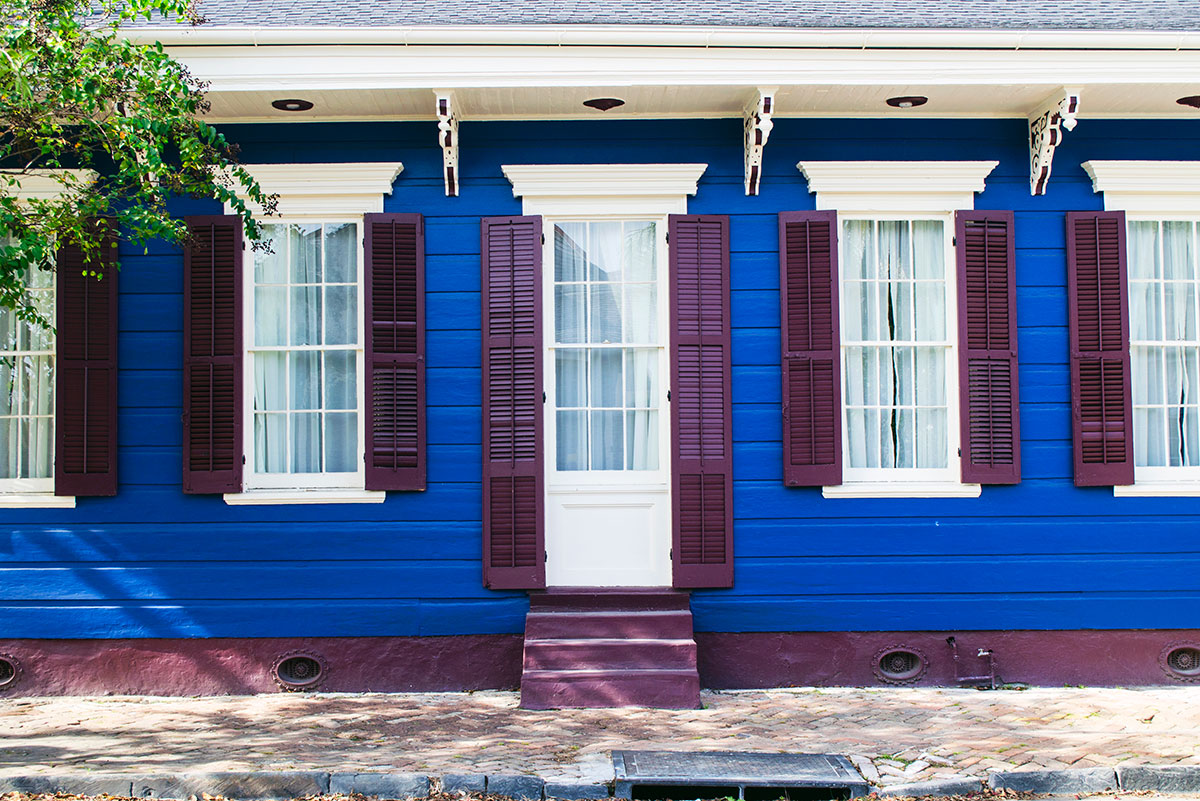 A blue house with purple shutters in New Orleans Louisiana