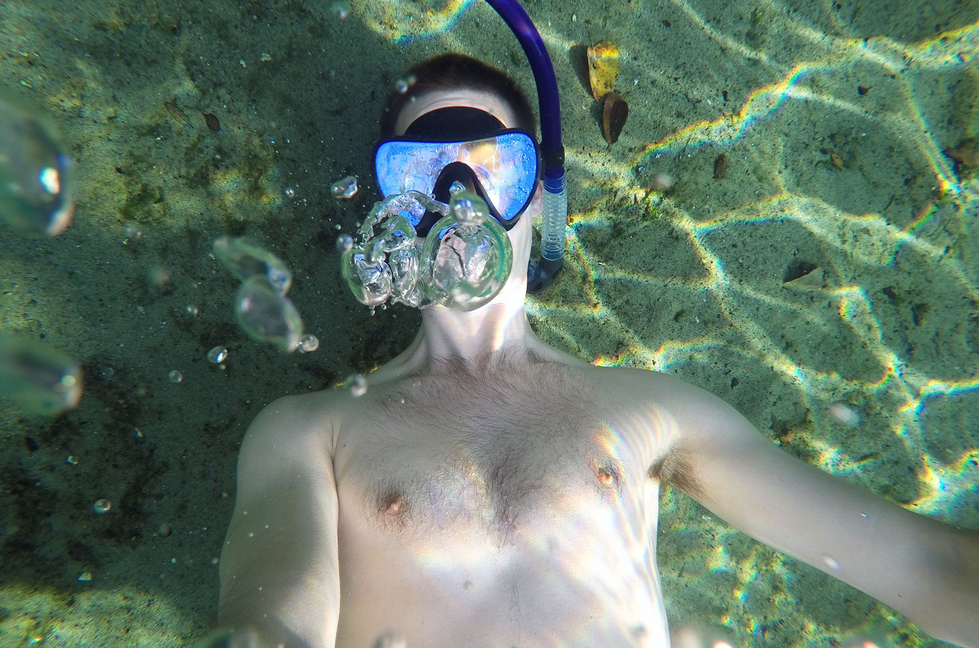 Brad blowing ring bubbles underwater at Wekiwa Natural Spring State Park in Florida during our gap year