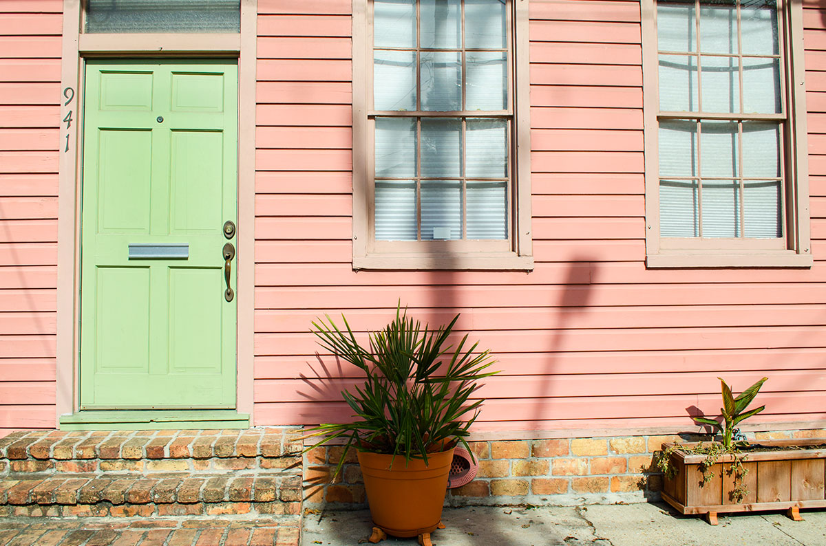 A pink house with a green door in New Orleans Louisiana