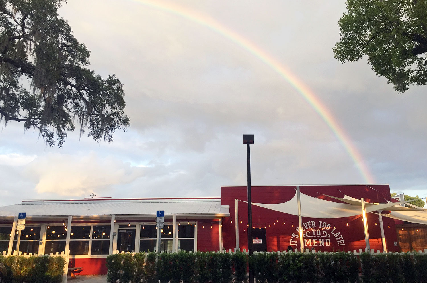 A rainbow over the outdoor eating area of The Coop in Orlando