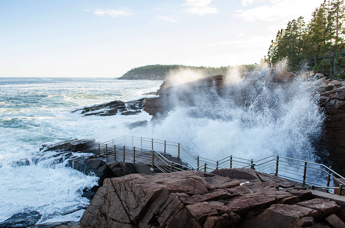 Wave crashes at Thunder Hole in Acadia National Park Maine