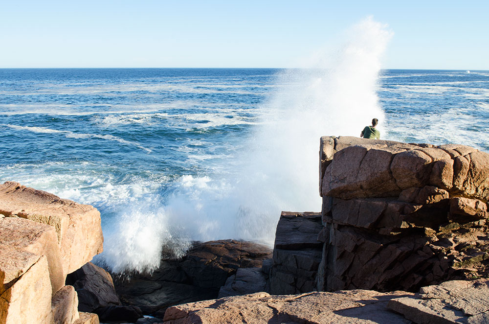 Brad getting splashed on the rocky coast of the Ocean Path in Acadia National Park in Maine during our gap year