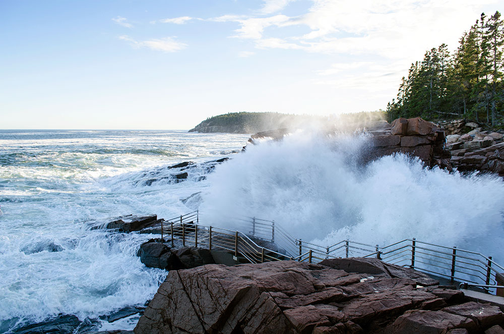 A big splash from a wave crashing into Thunder Hole at Acadia National Park