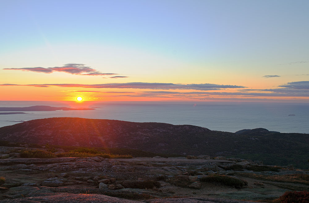 The view of the sunrise over the Atlantic Ocean from the top of Cadillac Mountain