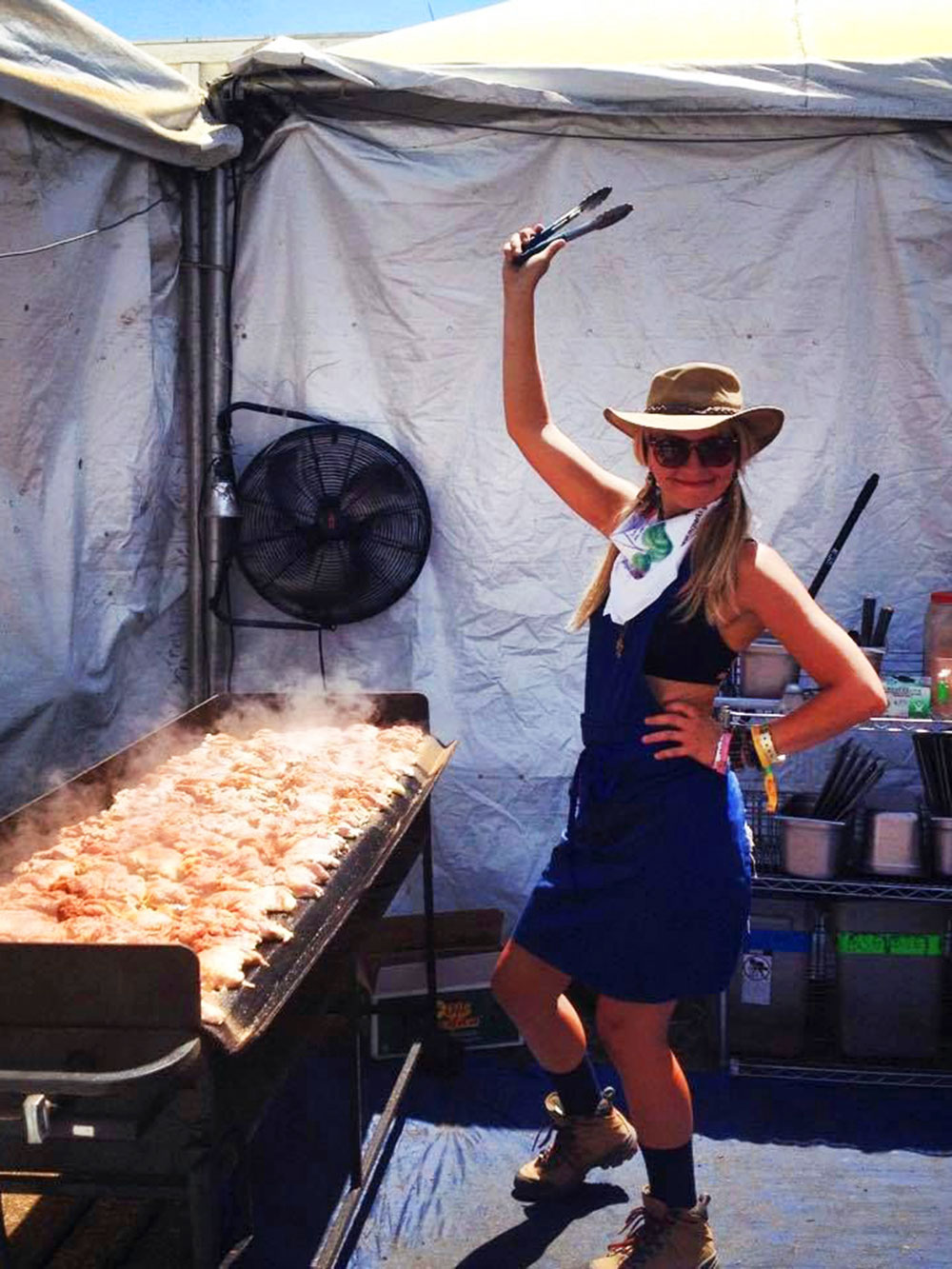 Kellie Mogg cooking 40 pounds of chicken for the Peace Love Tacos Food Truck at Coachella Music Festival