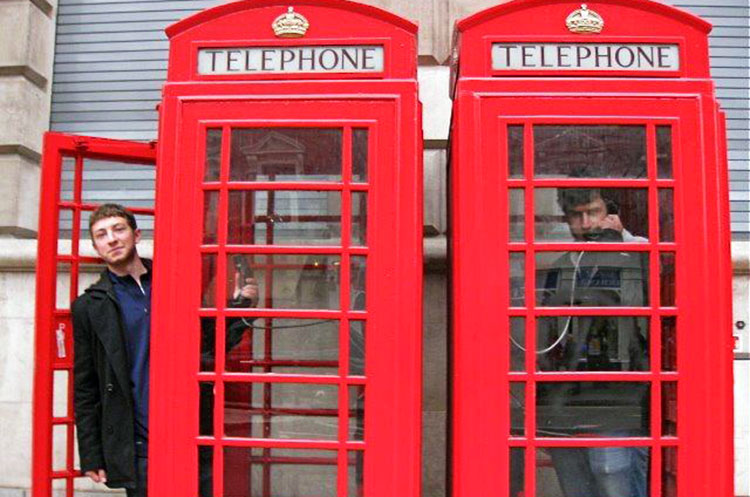 Danny Magerman stands in the doorway of a London phone booth during a break from Kivunim