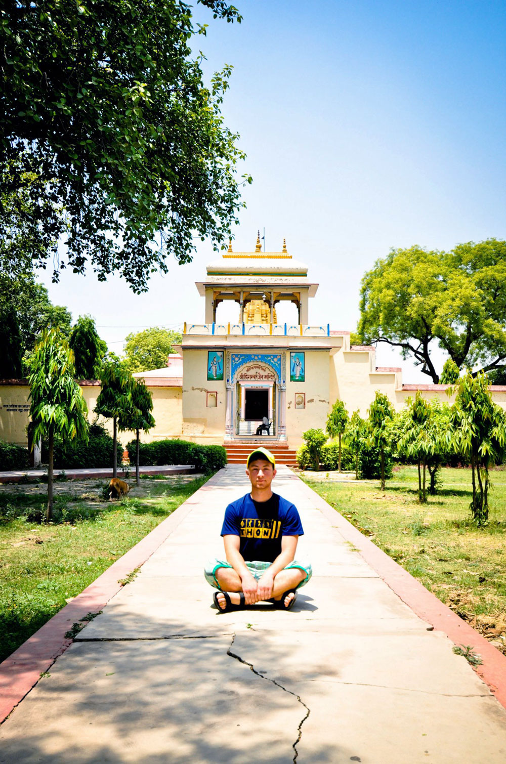 Danny Magerman sitting in front of a temple in India