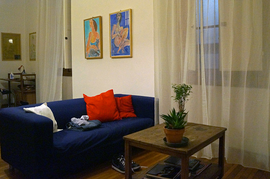 The couch at the first Florence Airbnb we rented for our first airbnb experience