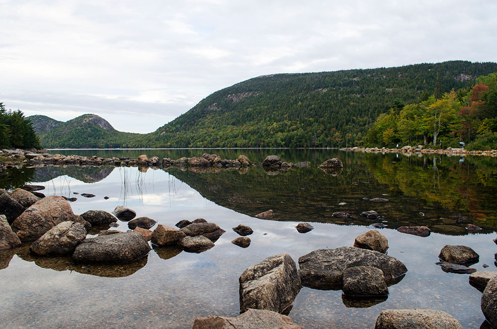 A reflection of a mountain on Jordan Pond in Acadia National Park