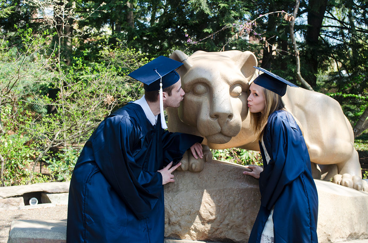 About Us: Brad and Leslie kissing the Nittany Lion Shrine at Penn State University in State College Pennsylvania