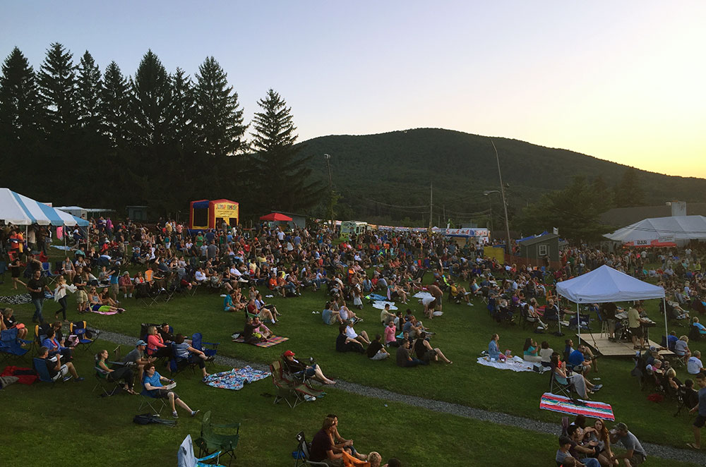 People sitting on a hill at Tussey Mountain Wing Fest