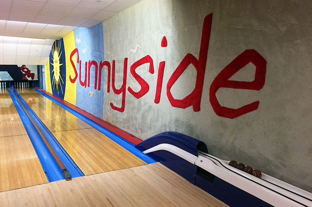 A carpeted wall inside Sunnyside Bowling Alley