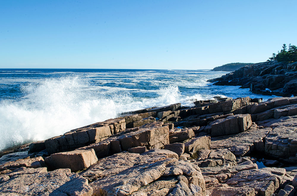 Water splashing along the rocky coast of the Ocean Path in Acadia National Park Maine
