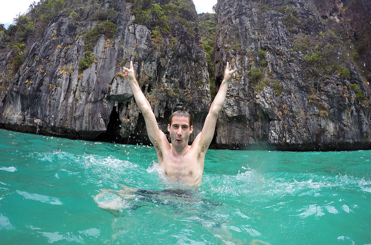 A guy swimming in a bay with Thalassa Tours in the Phi Phi Islands