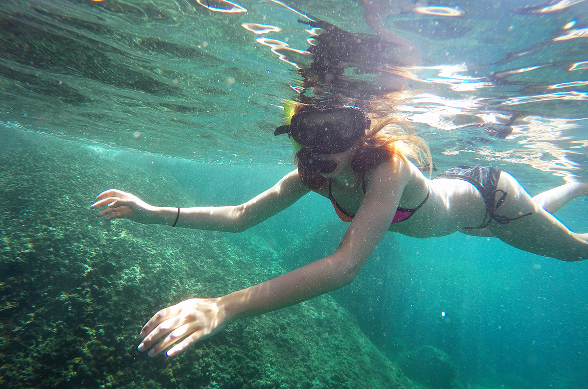 A girl snorkeling near the Phi Phi Islands with Thalassa Tours