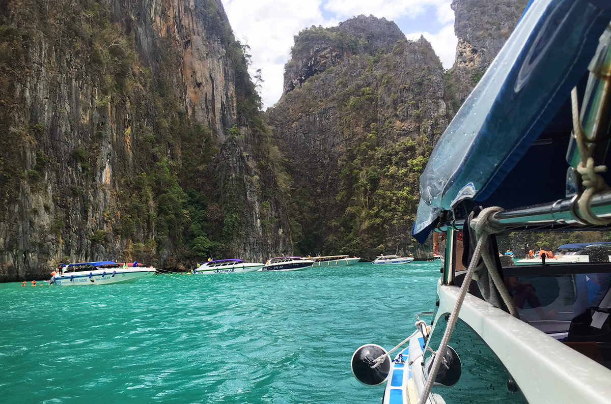 Thalassa Tours speed boat pulling into a bay in the Phi Phi Islands