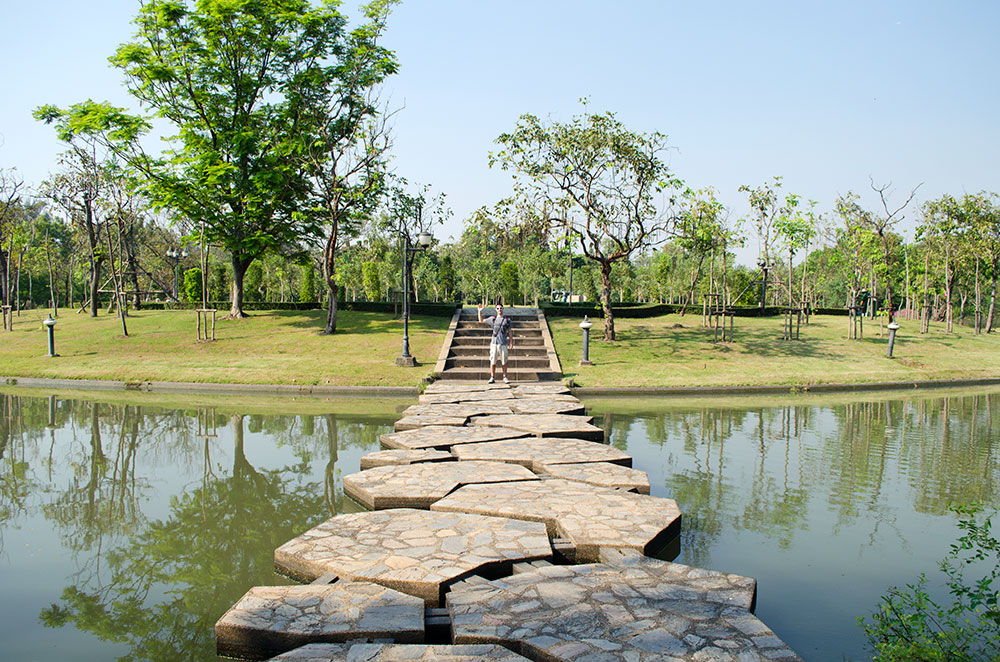 Brad walking across one of the many stone bridges in Bangkok's Queen Sirikit Park