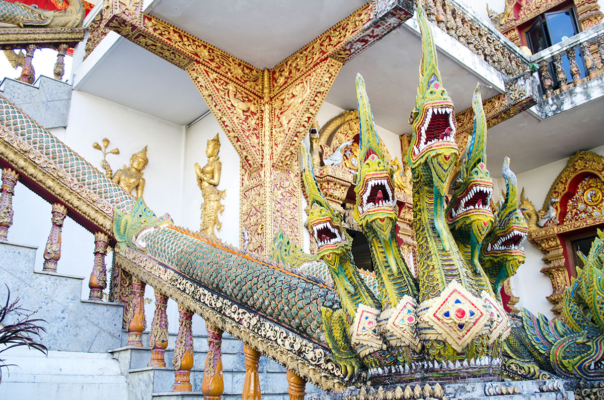 Beautiful sculpture of dragons on a railing at Wat Buppharam in Chiang Mai