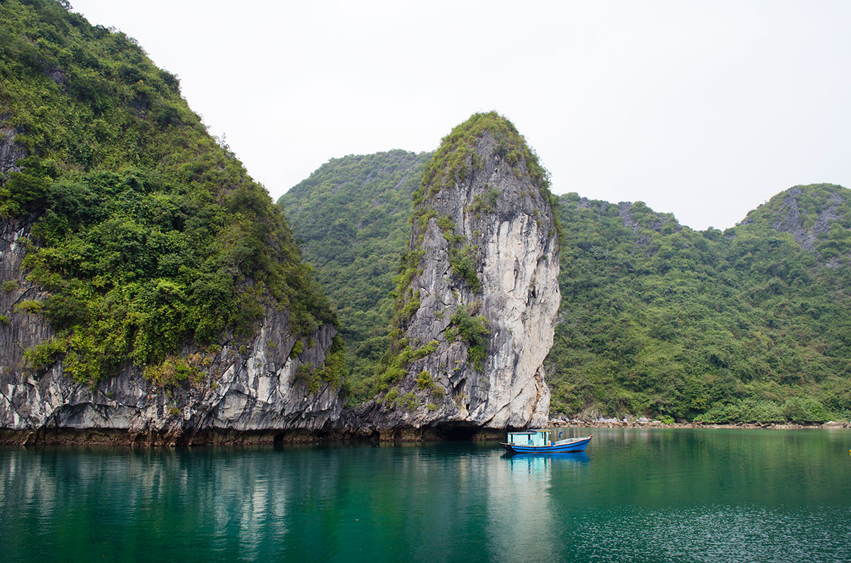 A blue fishing boat in Halong Bay