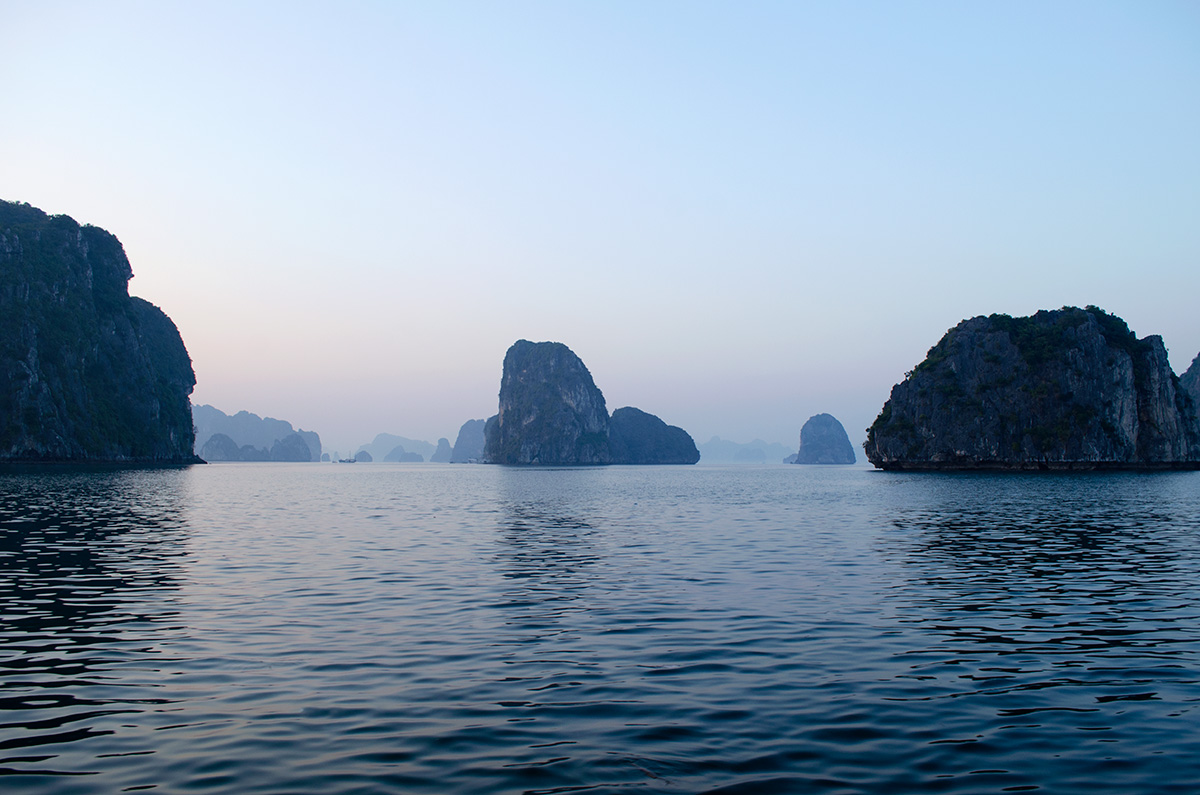 The blue waters of Halong Bay with islands in the background