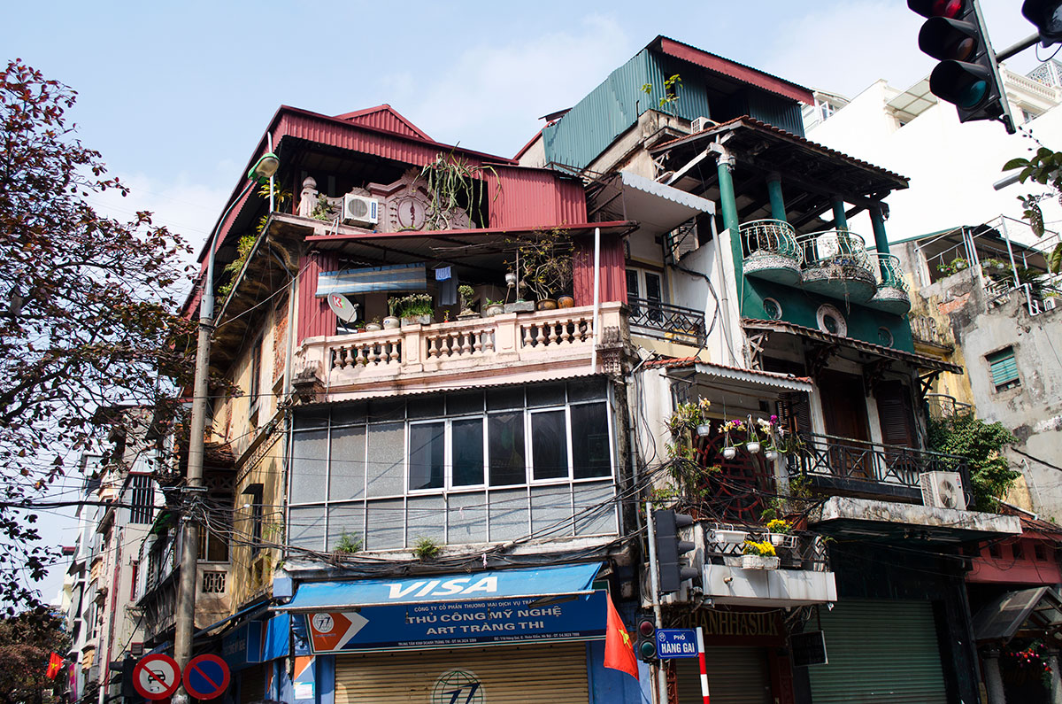 An eclectic architecture building with several apartments in Hanoi Vietnam