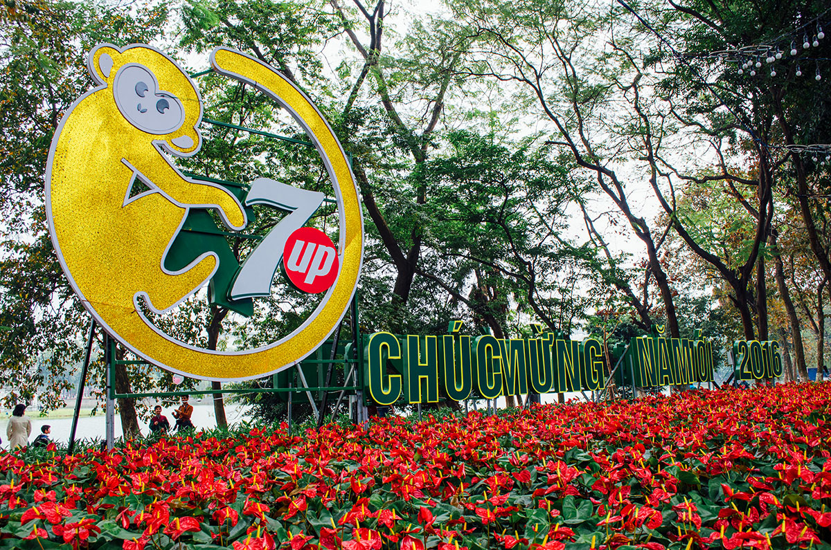 7up year of the monkey Chinese New Year sign near lake hoan kiem in Hanoi