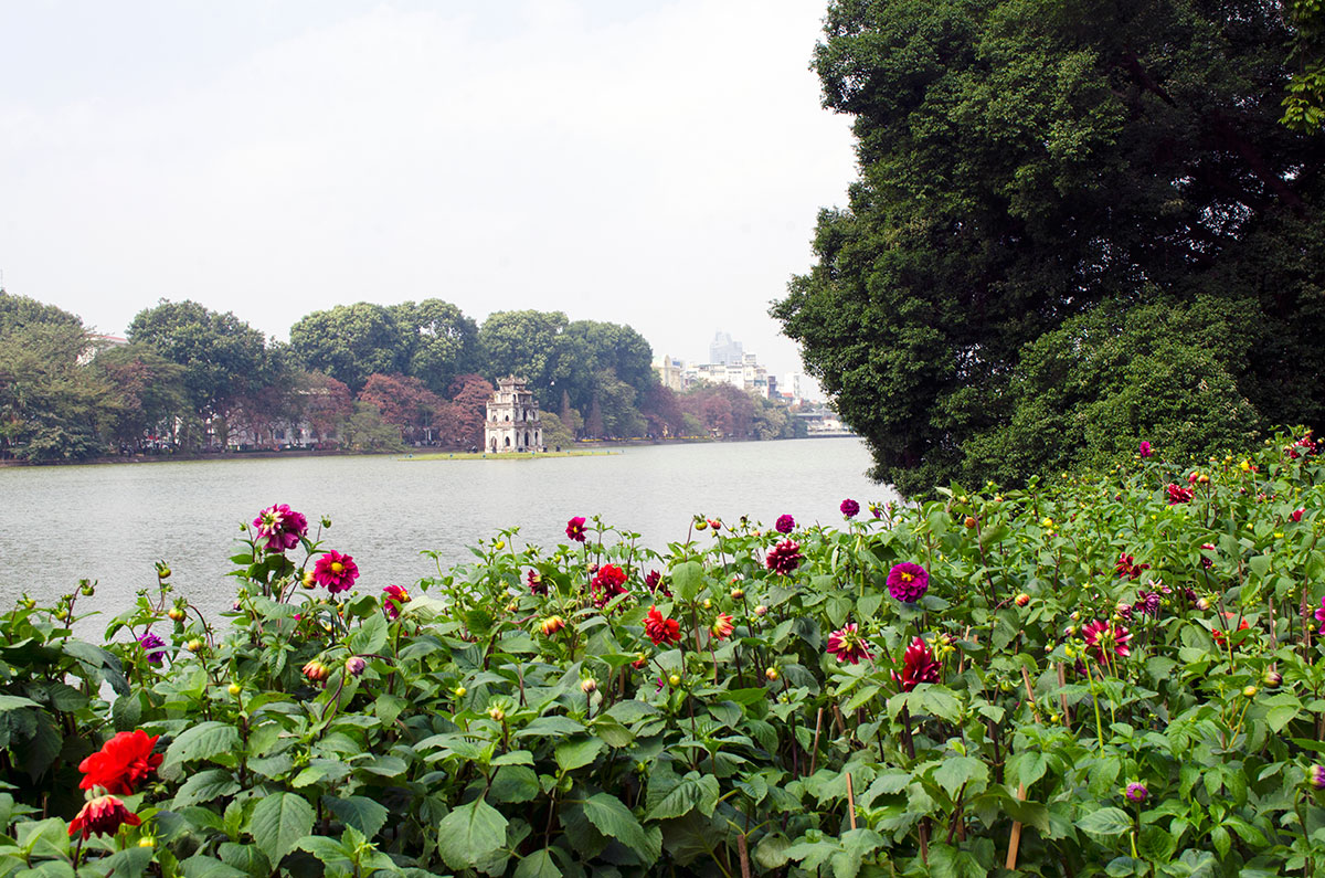 Flowers in front of the Lake of the Restored Sword in Hanoi Vietnam