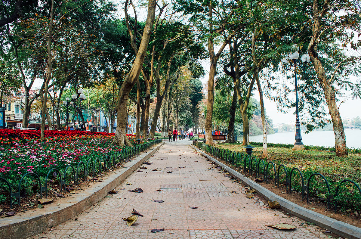 A path running alongside lake hoan kiem in Hanoi