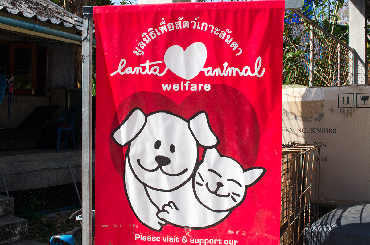 A red sign for Lanta Animal Welfare in Koh Lanta