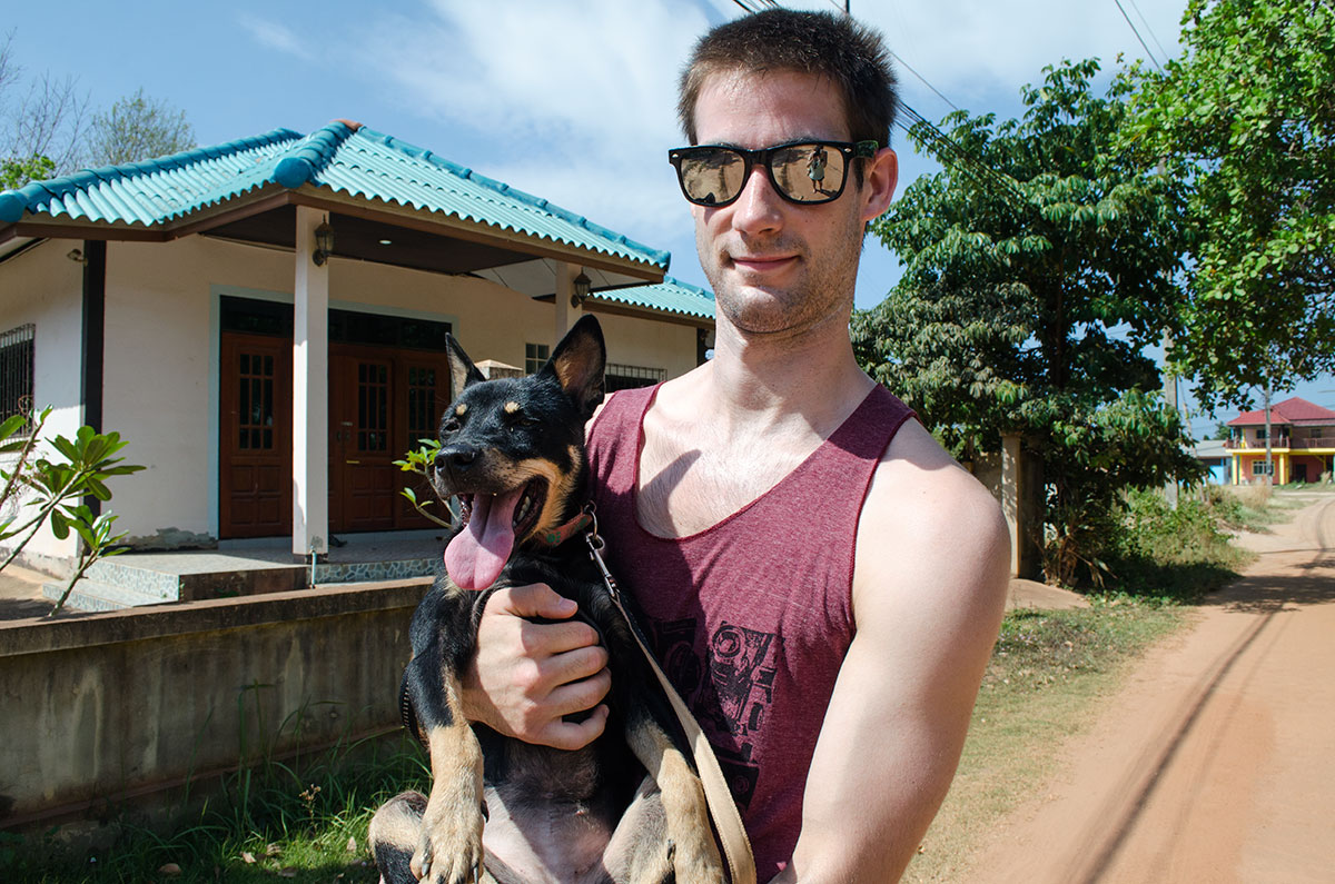 Carrying a dog from Lanta Animal Welfare in Koh Lanta Thailand