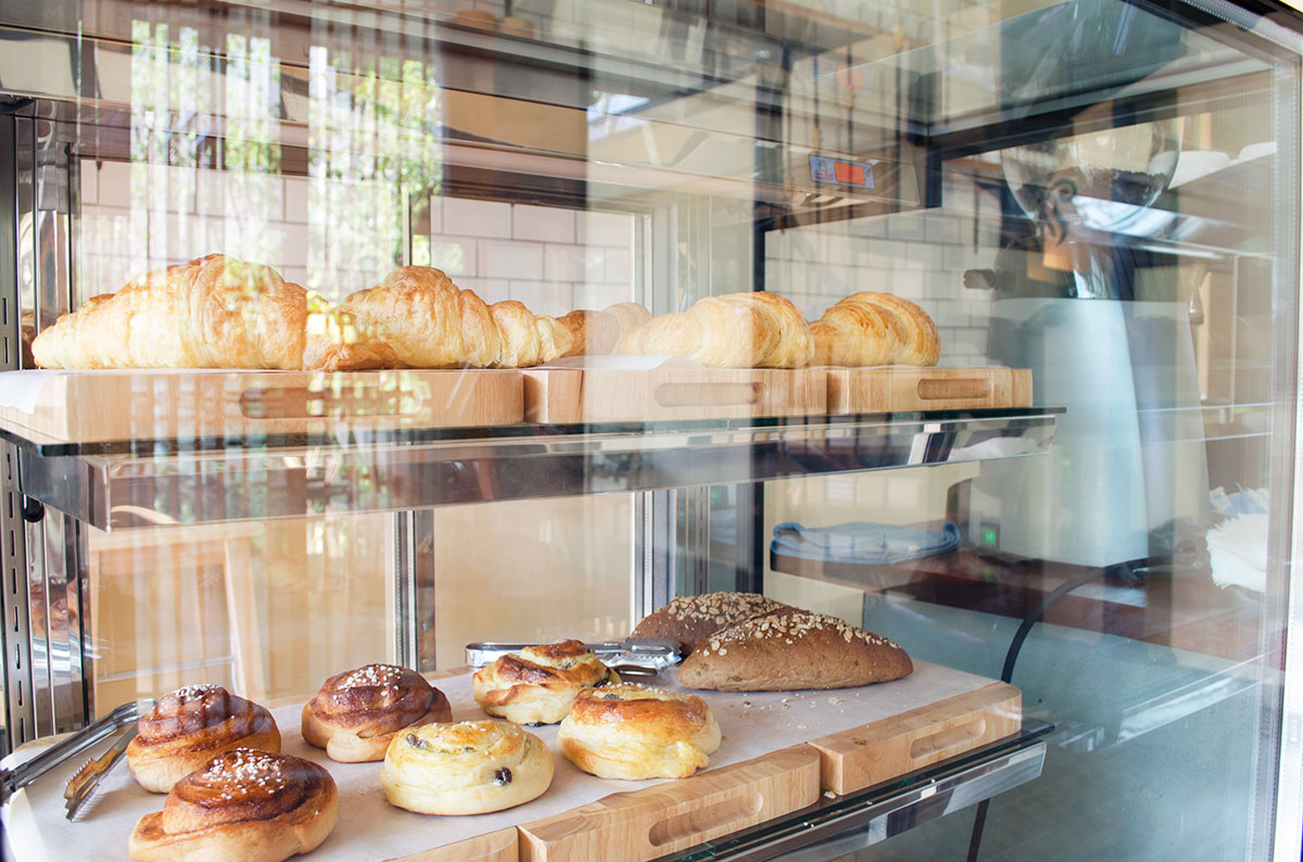 Baked goods in a display case at Fruit Tree Lodge Cafe in Koh Lanta