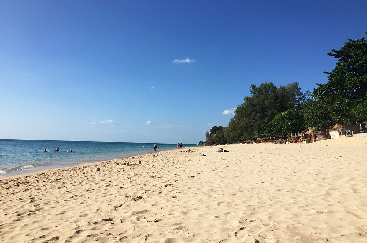 A beach with white sand and blue waters in Koh Lanta Thailand