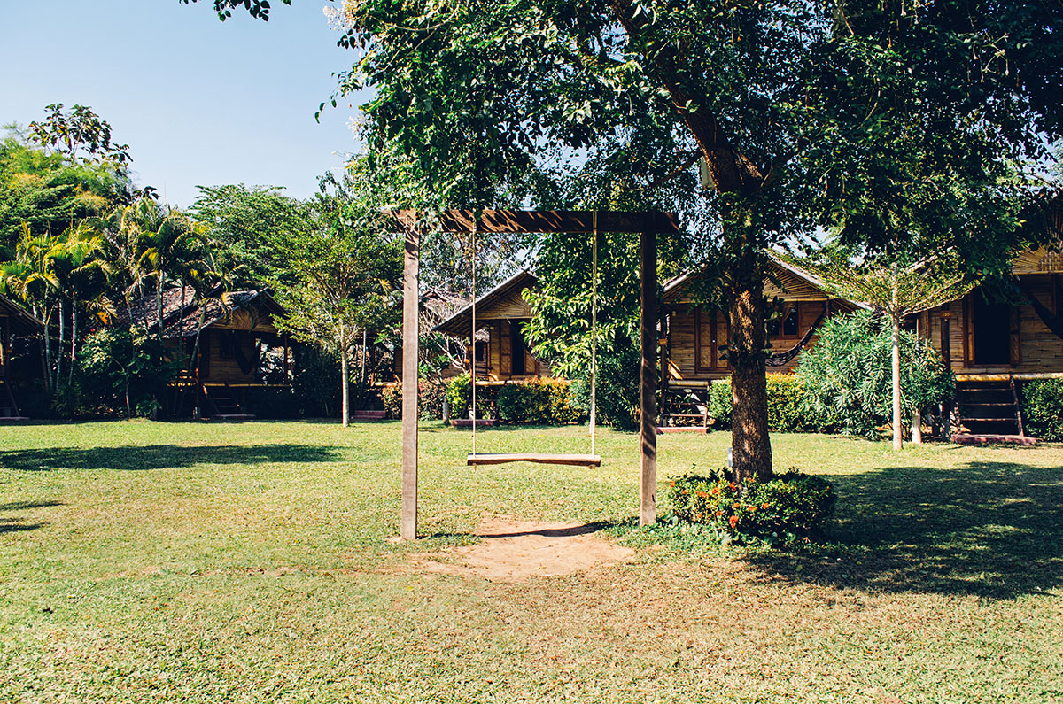 A swing in the middle of bungalows at Pai Country Hut