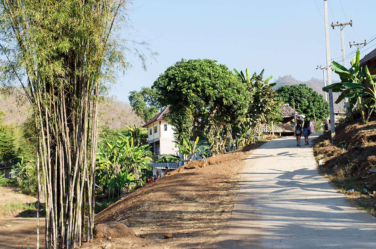 Walking along a street in the hills of Pai Thailand
