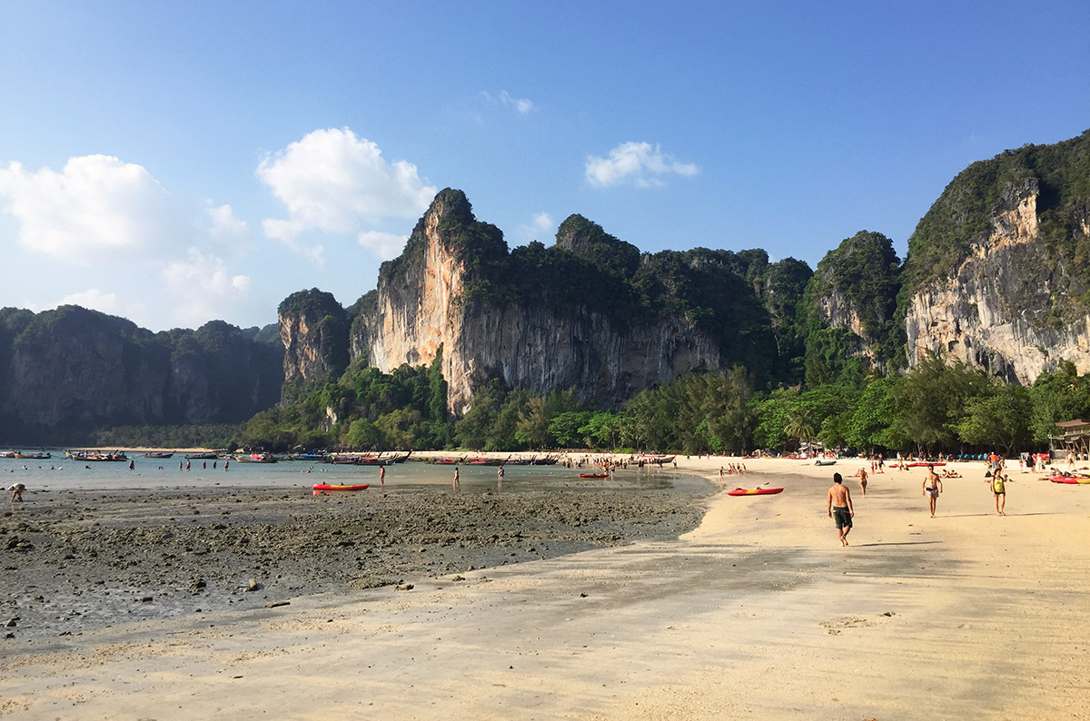 Low tide at Railay Beach with limestone mountains in the background