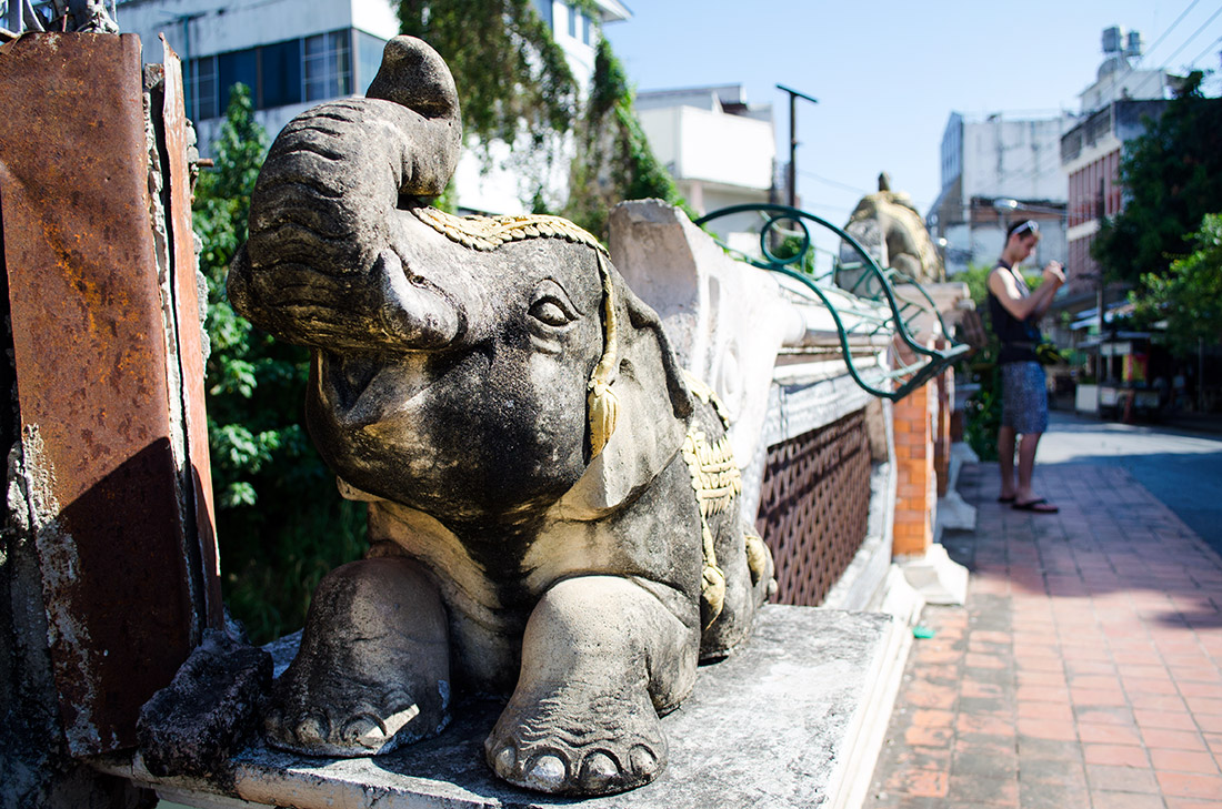 A decorative elephant statue on a bridge in Chiang Mai